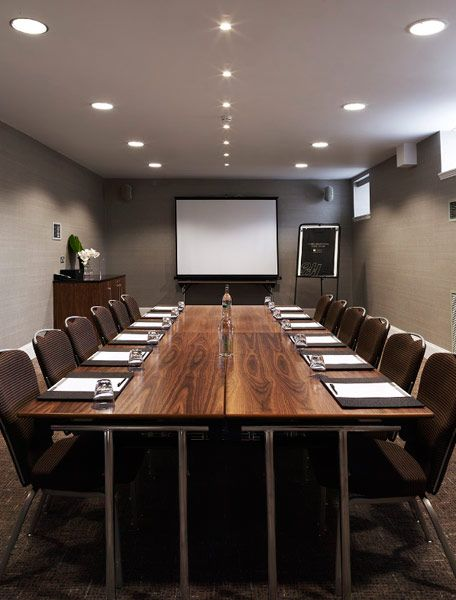 Modern corporate office table with chairs